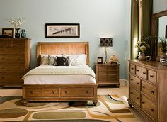 With storage drawers conveniently built into the bed's footboard, this Coventry 4-piece queen platform-look bedroom set with storage bed is the next best thing to a walk-in closet! Plus, the streamlined drawer fronts, softly arched headboard, cathedral grains and turned bun feet make this queen bedroom set a transitional decorator's dream.<br /><br />Bedroom chest displayed is sold separately.