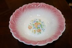 Vintage bowl, rose/pink color on edges, white inside color with orange/yellow/blue flowers, 8 1/4 inches in diameter. on Etsy, $15.00
