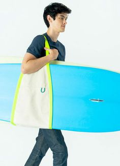 Canvas sling for carrying big awkward stuff: surf boards, snow boards, boxes, cool. by BAGGU