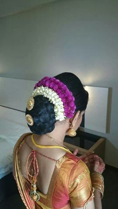 So beautiful, so traditional braided bun decked up with those beautiful flower gajras. But anyone who decides to use this hairstyle must be aware of the side effects i.e. the heavy static charge will bring up phlegm into the throat causing the voice to quaver. To prevent this, make sure to wear a heavy chabi chhalla with a long  wide hook just besides the pleats, which will prevent this problem due to acupressure exerted by the hook.