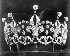 A beautiful belle epoque tiara, 1898, by Boucheron and made for Lady Curzon of Kedlestone. Designed as a series of five interlinked fleur de lys, with diamond spacers and over-arches of five diamonds; with each fleur de lys topped by a large circular diamond.