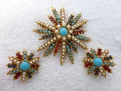 Signed ART brooch and earring set in a star by MeyankeeGliterz