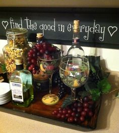 Tray, fake cheese and grapes with wine bottles. Kitchen decor