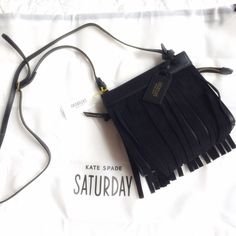 Kate Spade Saturday MINI Sway Bag The cutest little crossbody bag that is sold out everywhere and very rare! Black leather with black suede fringe on both sides.  Inside it is lined and it has gold hardware and an adjustable strap.  Includes dust bag.  Brand new with tags! kate spade Bags Crossbody Bags