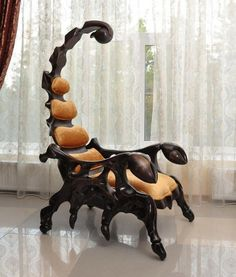 The fearsome Scorpion Chair is a handcrafted wooden chair that is shaped like a scorpion. The chair measures in at six and a half feet and is available with leather upholstery and a variety of wood. Awsome design different and looks solid.