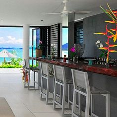Bar with ocean views at this beach-front mansion in Thailand designed by Jean-Michel Gathy. Credit for this modern home: Hunter | Sotheby's International Realty
