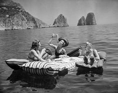 "swearronchanel: "" hauntedbystorytelling: "" Three young women eat spaghetti on inflatable mattresses at Lake of Capri, 1939 (AP Photo / Hamilton Wright) "" the life I want to live "" Vintage Italy, Italia Vintage, Weird Vintage, Vintage Photographs, Vintage Photos, Cristina Ferreira, Photography Beach, Photography Magazine, Editorial Photography"