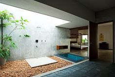 The Cliff House in Chowara, All bathrooms have tropical open-to sky courts that are integrated visually with the bedrooms and several open courts. Architects Sandeep Khosla and Amaresh Anand of Khosla Associates