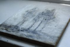 This is a miniature landscape painting in oils encased in layers of encaustic wax.   Created by painting with oils between layers of wax the works have a deep sense depth and detail.