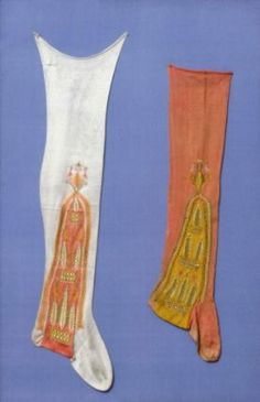 Pair of stockings        Italian, 17th century         Probably Spain  Dimensions      22 x 49 cm (8 11/16 x 19 5/16 in.)  Medium or Technique      Silk; knitting and embroidery    Accession Number      43.1941a-b