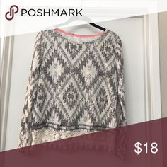 Long sleeved top Never been worn 56% cotton and 44% polyester. Cream and gray with lace trim along the bottom. Tops
