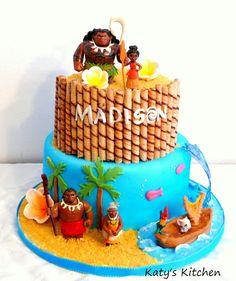 Katy's Kitchen: Moana Cake. Featuring Moana toys, sugar plumeria flowers, isomalt wave, and fondant canoe.