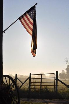Old Glory flying faithfully in the morning. We are proud to be made in the USA at Bison Built!