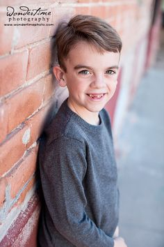 Taken during our urban downtown family photo session in Tucson, Arizona, this is my oldest child who is waiting for some teeth to come in! :D www.wondertimephoto.com
