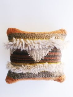 """The Sunset Pillow Price$56.00  From the Merry & Bright Collection: The Sunset Pillow. This hand woven pillow features umber, smoke, and cloud colors reminiscent of the perfect Fall sunset.   Wool and cotton with canvas backing. Measures 12"""" x 12""""."""