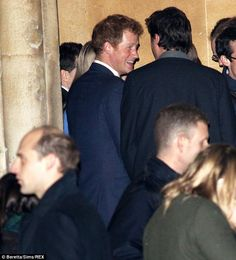 Good humoured: Prince Harry chats with a friend outside St Luke's Parish Church in Chelsea
