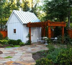 An accompanying pergola on this she-shed extends its utility to a social space worthy of outdoor parties. This shed, designed by ONE 10 STUDIO Architects, echoes the modern design of the homeowner's nearby renovated farmhouse with modern sensibilities.