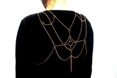 This is a gold plated chain body harness that is worn like a necklace and goes around the waist as well. It is a true showstopper because of the