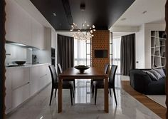 Open plan living area with a sleek kitchen and smart dining space