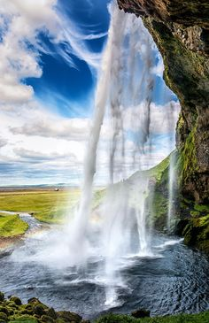 Seljalandsfoss II Iceland. Have a pic of hubby under frozen falls...incredible, & super scary, no rails or safety marked areas not even at geysers!