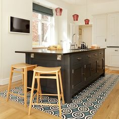 White kitchen with black island and feature floor tiles   Kitchen decorating   housetohome.co.uk