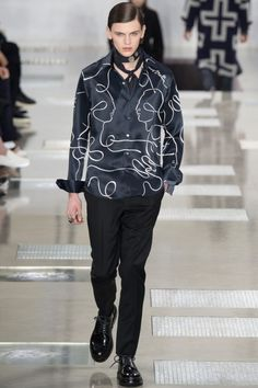 Louis Vuitton embraces a faces print for a chic graphic touch to its fall-winter 2016 men's collection.