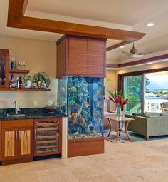 Goldfish Tower  This towering rectangular aquarium design flows seamlessly with the surrounding wood.