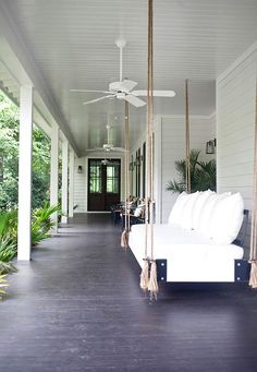 A beautiful bungalow home was designed for family living by Heather A Wilson, Architect along with designer Jen Langston in Mount Pleasant, South Carolina. Home Porch, House With Porch, Porch Bed, Fun House, Indoor Outdoor Living, Outdoor Rooms, Outdoor Daybed, Outdoor Fans, Outdoor Swings