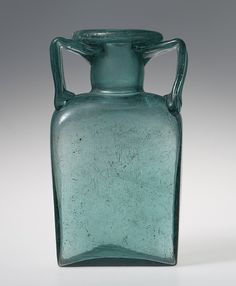 Storage jar, 2nd–3rd century A.D. Roman Mold-blown glass; 6 1/2 x 3 1/4 x 2 1/16 in. (16.5 x 8.3 x 5.2 cm) Gift of J. Pierpont Morgan, 1917 (17.194.219)