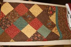 on point, simple quilt using a beautiful combination of colors.
