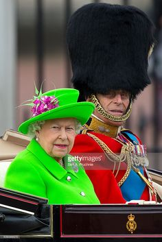 Queen Elizabeth II and Prince Philip, Duke of Edinburgh sit in a carriage during the Trooping the Colour, this year marking the Queen's 90th birthday at The Mall on June 11, 2016 in London, England. The ceremony is Queen Elizabeth II's annual birthday parade and dates back to the time of Charles II in the 17th Century when the Colours of a regiment were used as a rallying point in battle. (Photo by Ben A. Pruchnie/Getty Images)
