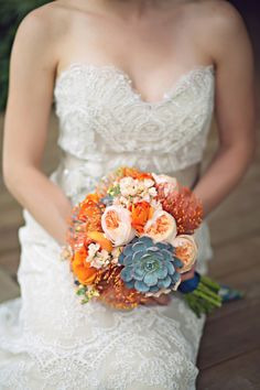 Orange bouquet of protea, succulents, garden roses and ranunculus- LOVE! Photo by Mishelle Lamarand Photography http://theeverylastdetail.com/2013/09/18/colorful-unique-rustic-michigan-wedding/