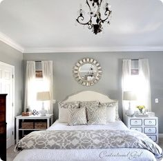 Gray Master Bedroom. I like that the nightstands don't match...something different :)