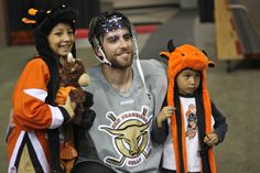 Dean Ouellet posing with fans at the Season Ticket Member open training camp on Wednesday, October 9th.