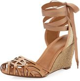 """Openwork laser-cut nubuck toe.     Nubuck trim at woven linen halter strap.     Self-tie grosgrain ribbon wraps around ankle.     3 1/4"""" woven raffia wedge.     Padded leather insole; leather lining.     Rubber outsole.     Made in Brazil."""