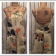 Super cute summer romper! Amazing fabric. Great quality, and super cute! Tops
