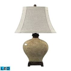 Check out the Dimond Lighting 113-1132-LED Normandie 1 Light Ceramic Distressed Floral Glaze LED Table Lamp in Sky Valley with Bronze
