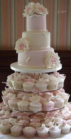 wedding cake w cupcakes. Here's an example of the decorated cupcakes. :) Like how the cupcakes have different decorations like butterflies. Pretty Cakes, Beautiful Cakes, Amazing Cakes, Wedding Cakes With Cupcakes, Cupcake Cakes, Cupcake Ideas, Pink Cupcakes, Flavored Cupcakes, Mini Cakes