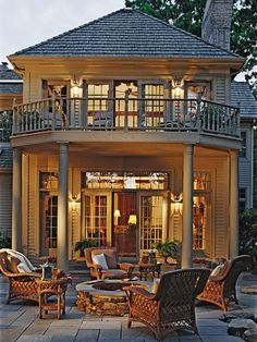 Soft Deck Lighting  For a harmonious look to your elevated outdoor haven, incorporate soft lighting in your deck plans. This large upper-level balcony is lit with fixtures mounted to the home's exterior. The space provides a bird's-eye view of the surrounding scenery.
