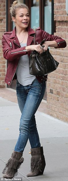 Stylish #LeAnn Rimes in skinny jeans, tasselled boots and a red leather jacket