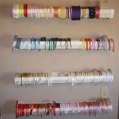 Ribbon Storage Mount sections of vinyl gutter on a wall and place your ribbon spools in them. When you pull on the ribbon, the spool spins in place. Look for gutter sizes that can accommodate your largest ribbon Ribbon Organization, Ribbon Storage, Craft Organization, Organizing Ideas, Closet Organization, Craft Room Storage, Craft Rooms, Storage Ideas, Scrappy Quilts
