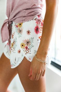 • Cream floral print short with elastic waist and lace trim • Available in sizes S, M, L. Model is wearing a size small • 100% Rayon