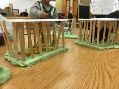 Adding open ended loose parts to Playdough creates many new opportunities for students. These children used Popsicle sticks to create a zoo for the animals.