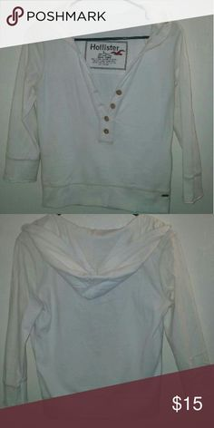 White Hollister Pullover Four buttons on the front and a hood. Only wore a couple of times. Like brand new! Hollister Sweaters