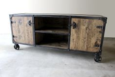 """Modern Industrial media console, tv stand with 5"""" casters. This is a handmade piece, all the wood has been hand scraped, distressed and stained for that unique reclaimed wood look. Solid pine and welded steel frame and round head rivets. Made in the USA by ModernIndustrialFurniture.com"""