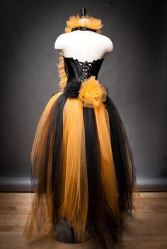 Size Small Orange and Black Feather Burlesque Corset Witch costume with Hat Ready to Ship. $499.00, via Etsy.