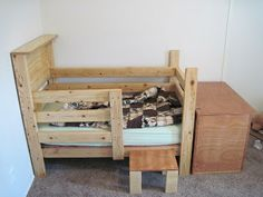 DIY Toddler Bed - stickykissesanddirtydishes.blogspot.com.  Sorry, no instructions, her husband was able to figure it all out in his head and build it.
