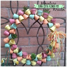 Miniature Terra Cotta Flower Pot Front Door Wreath / via DazzleWhileFrazzled blog
