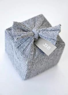 "Super fun gift wrap idea using an old sweater. Wonder if you could kick it up a notch with an ""ugly"" Christmas sweater!?!"