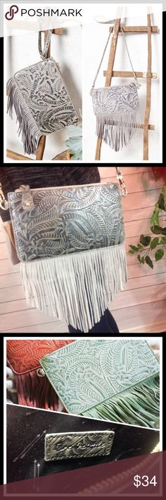 """Free People Tooled Fringe Gray Wristlet Crossbody Brand new FP tooled gray leather crossbody wristlet with suede fringe. Style 34539601 Sold out. Removable long strap and wristlet.  9 X 5"""".  Strap drop 24"""".                                         Please ask all questions before you purchase! I'm happy to help! Sorry, no trades or holds Please, no lowball offers Please use Offer Button! Bundle for best prices! Happy Poshing! Free People Bags Crossbody Bags"""